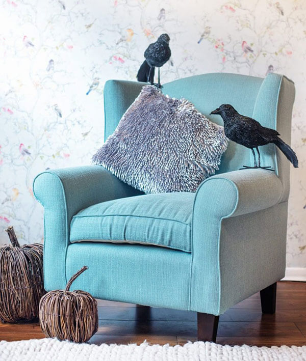 Crows and pumpkins decorations a blue armchair