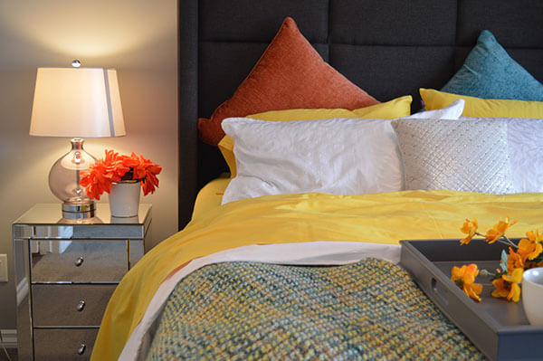 double bed with bright bed sheets