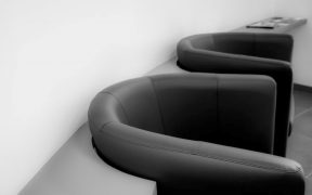 two faux leather black tubchairs