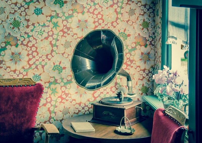 gramophone in front of floral wallpaper