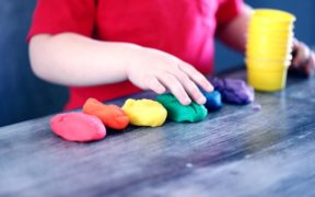 child playing with coloured clay